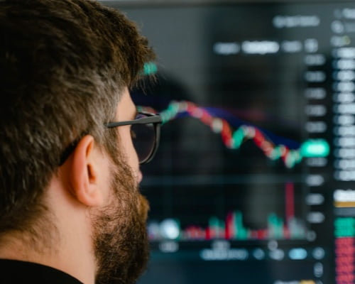 Guy Looking at Online Cryptocurrency Trading Chart